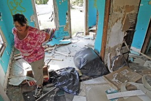 person assessing hurricane damage