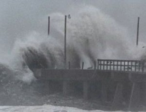 Storm surge hitting pier