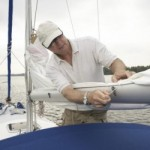 boat preparation for hurricane- man tying down boat
